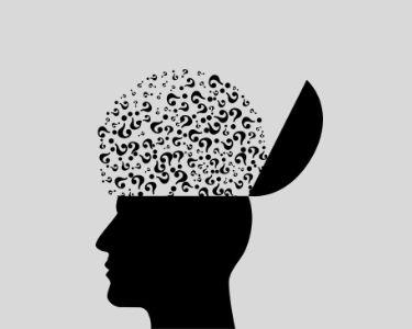 Ilustración de un cerebro llenos de signos de interrogación