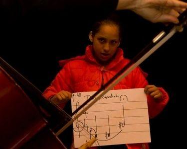 Niña y violín