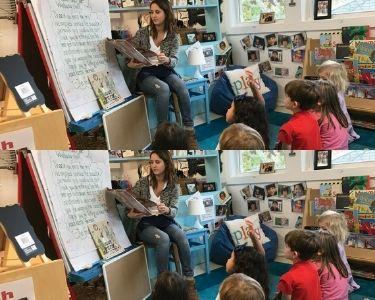 Fotografía de docente leyendo a sus estudiantes