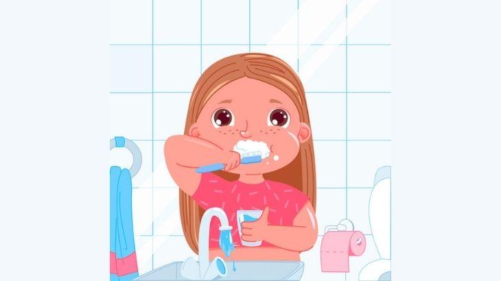 Niña que se lava los dientes desperdiciando agua
