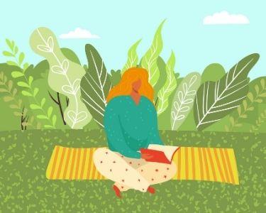 Imagen de una docente meditando en medio de un jardín.