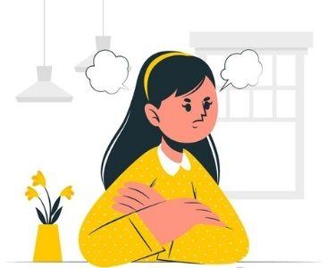 Una estudiante frustrada en el aula y una maño que la ayuda